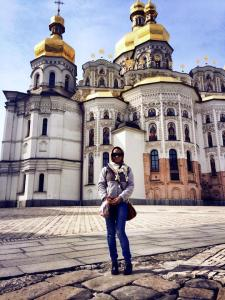 Standing in front of a church in the Lavra.