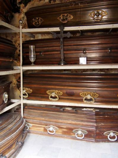 Coffins, inside a mausoleum.