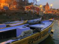 Locals sleeping on their boats on the River Ganges.