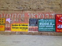 Adverts alongside the Ganges river.