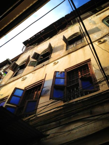 Looking up on my walk through Stone Town.