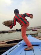 A small child who jumped aboard our boat to sell us marigolds.