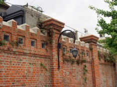 The cemetery is surrounded by high, brick walls.