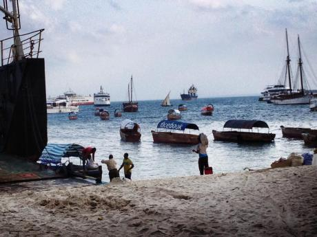 """Facebook"" boat on the beach at Stone Town ferry terminal."