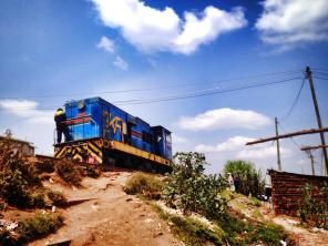 A locomotive engine passing through Kibera.