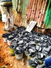 Buckets of coal for sale in Kibera.