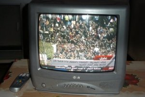 Watching the revolution unfold in Cairo on a small TV in the Dakhla Oasis.